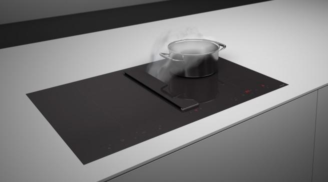 Ein Stück Schweizer Perfektion: Concept Swiss zeigt Abzugssysteme, die in Induktionskochfeldern integriert sind.