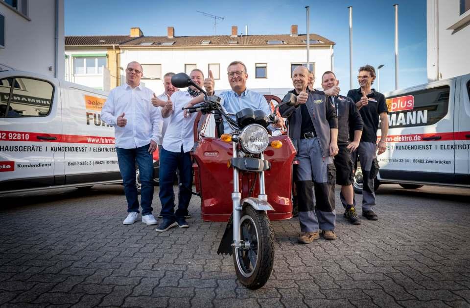 Ein starkes Team: Joachim Müller und seine Mitarbeiter versprechen Premium-Service für Premium-Produkte.